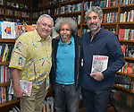 """CORAL GABLES, FL - MAY 17: Author Les Standiford, Former """"Angola 3"""" inmate Albert Woodfox and Mitchell Kaplan pose for a picture after Albert sign copies of his book """"Solitary"""" at Books & Books on May 17, 2019 in Coral Gables, Florida. ( Photo by Johnny Louis / jlnphotography.com )"""