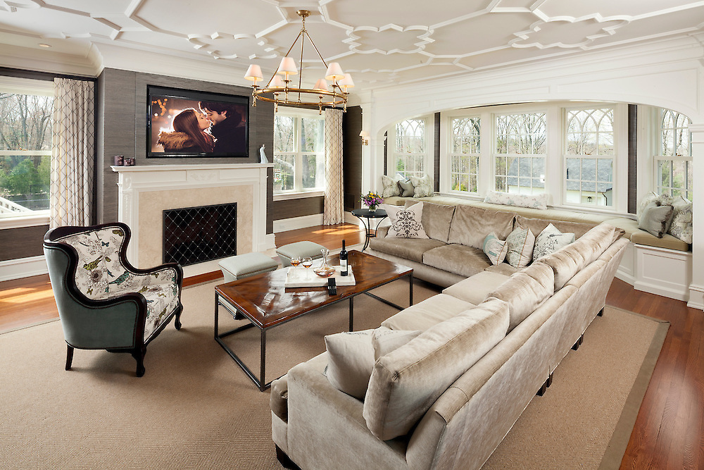 Family Room with Ceiling Detail and TV Above Fireplace