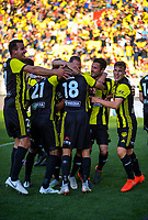 Phoenix players celebrate during the A-League football match between Wellington Phoenix and Newcastle Jets at Westpac Stadium in Wellington, New Zealand on Sunday, 21 october 2018. Photo: Dave Lintott / lintottphoto.co.nz