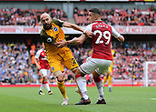 1st October 2017, Emirates Stadium, London, England; EPL Premier League Football, Arsenal versus Brighton; Bruno Saltor of Brighton is held back by Granit Xhaka of Arsenal as they attempt to chase a loose ball