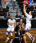 SIOUX FALLS, SD - MARCH 10:   Nate Bruneel #45 from the College of Idaho shoots over the defense of Marian during their quarterfinal game at the 2018 NAIA DII Men's Basketball Championship at the Sanford Pentagon in Sioux Falls. (Photo by Dave Eggen/Inertia)