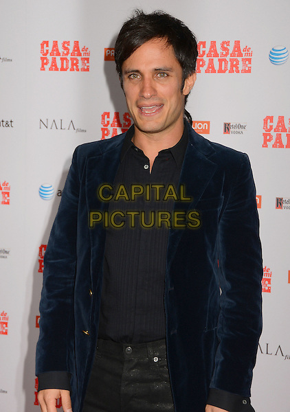 "Gael Garcia Bernal.""Casa de mi Padre"" Los Angeles Premiere at Grauman's Chinese Theatre, Hollywood, California, USA..March 14th, 2012.half length jacket black blue velvet jacket shirt mouth open.CAP/ADM/BT.©Birdie Thompson/AdMedia/Capital Pictures."