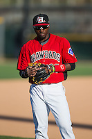 Travis Demeritte (25) of the Hickory Crawdads warms up in the outfield prior to the game against the Kannapolis Intimidators at L.P. Frans Stadium on April 23, 2015 in Hickory, North Carolina.  The Crawdads defeated the Intimidators 3-2 in 10 innings.  (Brian Westerholt/Four Seam Images)