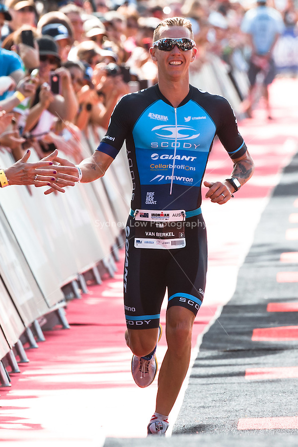 MELBOURNE, March 21, 2015 - Tim VAN BERKEL (AUS) #2 crosses the finish line to come second in the 2015 IRONMAN Asia-Pacific Championship in Melbourne, Australia on Sunday March 21, 2015. (Photo Sydney Low / sydlow.com)