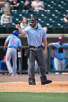Home plate umpire Brennen Miller makes a strike call during the Southern League game between the Tennessee Smokies and the Birmingham Barons at Regions Field on May 3, 2015 in Birmingham, Alabama.  The Smokies defeated the Barons 3-0.  (Brian Westerholt/Four Seam Images)