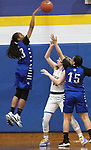 SEYMOUR CT. - 17 January 2020-011720SV07-#23 Tiahana Pulliam of Crosby High blocks the shot of  #33 Kilay Derzek of Seymour High during basketball action in Seymour Friday.<br /> Steven Valenti Republican-American