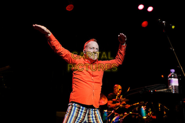 Fred Schneider<br /> The B 52's performing in concert, Indigo2, Greenwich, London, England. 16th August 2013<br /> on stage in concert live gig performance performing music half length orange shirt blue white stripe trousers   dancing hands arms in air  <br /> CAP/MAR<br /> &copy; Martin Harris/Capital Pictures