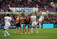 Jordi Amat of Swansea City (R) misses a header from a Swansea cross during the Premier League match between Swansea City and Hull City at the Liberty Stadium, Swansea on Saturday August 20th 2016