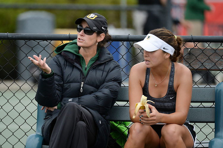 April 24, 2013; San Diego, CA, USA; San Francisco Dons women's tennis head coach Hilary Somers (left) and player Marina Nikolic during the WCC Tennis Championships at Barnes Tennis Center.