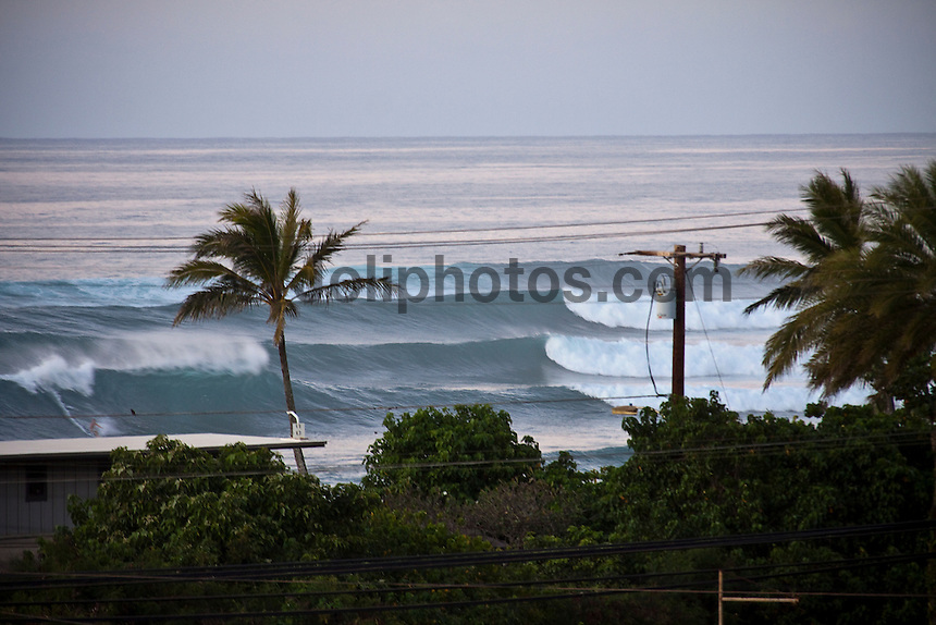 HALEIWA, HI (Thursday Dec. 3, 2009) Huge surf hitting the  North Shore, Haleiwa, Oahu, Hawaii.  Big surf at Sunset Beach and Waimea Bay..The northern hemisphere winter months on the North Shore signal a concentration of surfing activity with some of the best surfers in the world taking advantage of swells originating in the stormy Northern Pacific. Notable North Shore spots include Waimea Bay, Off The Wall, Backdoor, Log Cabins, Rockpiles and Sunset Beach... Ehukai Beach is more  commonly known as Pipeline and is the most notable surfing spot on the North Shore. It is considered a prime spot for competitions due to its close proximity to the beach, giving spectators, judges, and photographers a great view...The North Shore is considered to be one the surfing world's must see locations and every December hosts three competitions, which make up the Triple Crown of Surfing. The three men's competitions are the Reef Hawaiian Pro at Haleiwa, the O'Neill World Cup of Surfing at Sunset Beach, and the Billabong Pipeline Masters. The three women's competitions are the Reef Hawaiian Pro at Haleiwa, the Gidget Pro at Sunset Beach, and the Billabong Pro on the neighboring island of Maui...Photo: Joliphotos.com