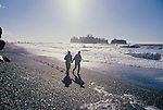 Olympic National Park, Rialto Beach, Washington State, Pacific Northwest,  couple hiking at low tide, sea stacks, Olympic Peninsula, USA, Pacific Ocean, Northwest coast.