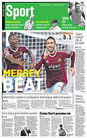 The Sunday Times 21-Sep-2014 - 'MERSEY BEAT' - 'Happy Hammers: Morgan Amalfitano, right, celebrates after scoring West Ham United's third goal against Liverpool. Diafra Sakho, left, scored the second after just seven minutes at Upton Park last night' - Photo by Rob Newell (Digital South)