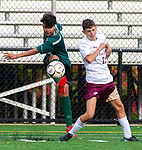 WATERBURY,  CT-101619JS15-  Wilby's Gerrson Coello (8) clears the ball in front of Sacred Heart's Danny Mara (11) during their NVL game Thursday at Municipal Stadium in Waterbury. <br />  Jim Shannon Republican-American