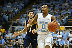 28 December 2015: North Carolina's Nate Britt (0) and UNC Greensboro's Demetrius Troy (11). The University of North Carolina Tar Heels hosted the UNC Greensboro Spartans at the Dean E. Smith Center in Chapel Hill, North Carolina in a 2015-16 NCAA Division I Men's Basketball game. UNC won the game 96-63.