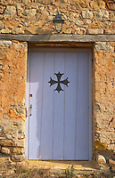 Domaine de Canet-Valette Door marked with the Languedoc Cathar cross Cessenon-sur-Orb St Chinian. Languedoc. A door. France. Europe.
