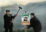South kerry Independent jackie Healy-Rae runs his own style of campaign and on friday he was still putting up posters with his son Michael in strategic places around Kenmare.<br /> Picture by Don MacMonagle