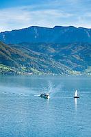 Austria, Upper Austria, Salzkammergut: excursion boat and sail boat on lake Attersee and Hoellen mountains at background | Oesterreich, Oberoesterreich, Salzkammergut: Ausflugsschiff und Segelboot auf dem Attersee, im Hintergrund das Hoellengebirge