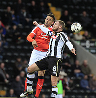Olly Lee of Luton Town beats Michael O'Connor of Notts County to the ball in the air during the Sky Bet League 2 match between Notts County and Luton Town at Meadow Lane, Nottingham, England on 29 October 2016. Photo by Liam Smith / PRiME Media