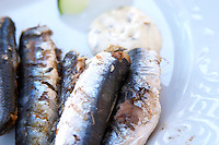 Grilled sardines on a plate. Hotel and restaurant Kompas. Uvala Sumartin bay between Babin Kuk and Lapad peninsulas. Dubrovnik, new city. Dalmatian Coast, Croatia, Europe.