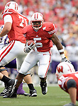 MADISON, WI - SEPTEMBER 9: Running back Lance Smith-Williams #5 of the Wisconsin Badgers carries the ball against the Western Illinois Leathernecks at Camp Randall Stadium on September 9, 2006 in Madison, Wisconsin. The Badgers beat the Leathernecks 34-10. (Photo by David Stluka)