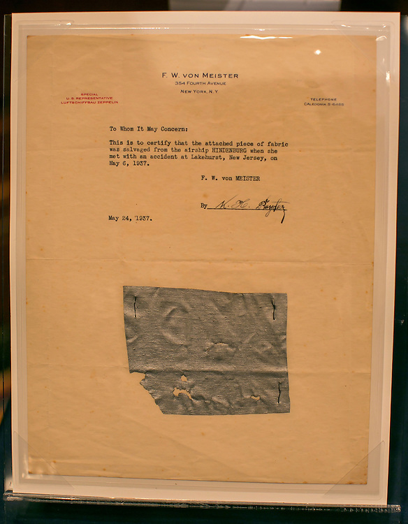 "UNITED STATES - JUNE 17 - A piece of fabric that is believed to be salvaged from the Hidenburg airship on a sheet of stationery with the letterhead of F.W. von Meister is seen on display from the National Postal Museum before a House Administration Committee Hearing on ""The State of the Smithsonian"" in the Longworth House Office Building on Wednesday, June 17, 2015. (Photo By Al Drago/CQ Roll Call)"