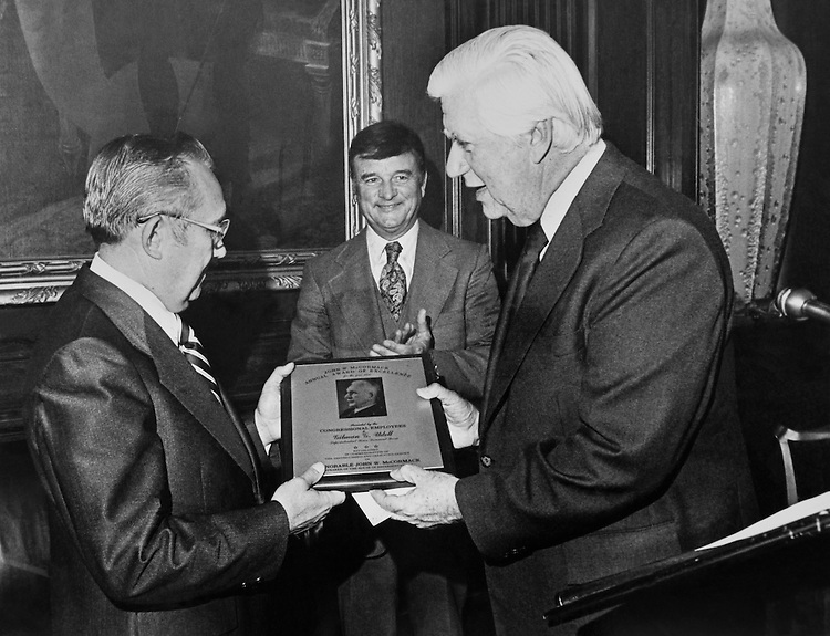 "Speaker of the House, Rep. Thomas Phillip ""Tip"" O'Neill, House Majority Leader giving an award to Gihman Udell in Ken Harding's office. (Photo by Dev O'Neill/CQ Roll Call)"