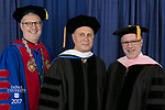 Left to right, the Rev. Dennis H. Holtschneider, C.M., president of DePaul, commencement speaker and honorary degree recipient John Corigliano, a Grammy Award-winning American composer, and Ronald Caltabiano, dean of the School of Music. DePaul University School of Music and The Theatre School held its commencement ceremony, Saturday, June 10, 2017, during the DePaul University School of Music and The Theatre School commencement ceremony at the Rosemont Theatre in Rosemont, IL. (DePaul University/Jeff Carrion)