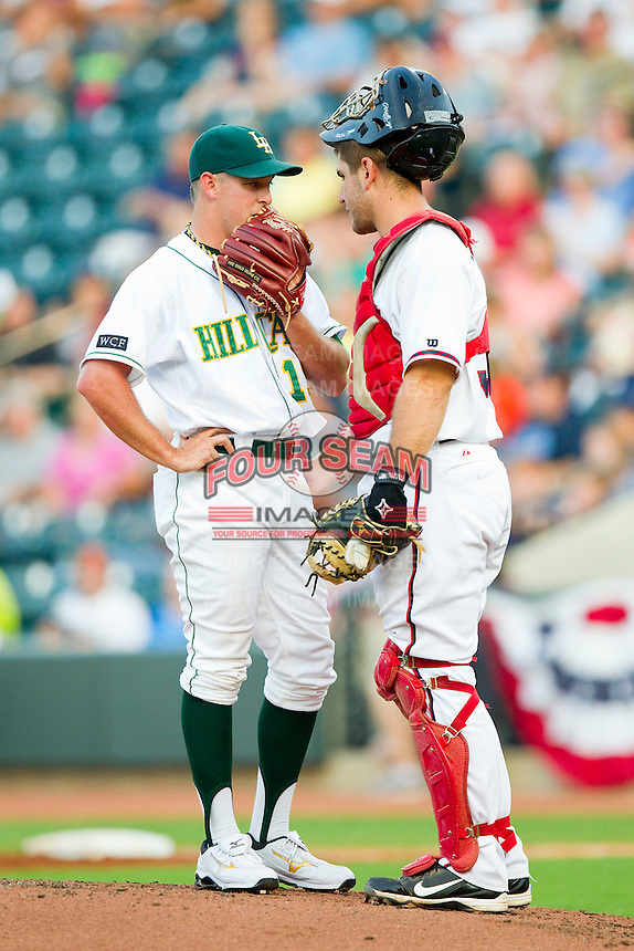 Pitcher J.R. Graham #13 of the Lynchburg Hillcats chats with catcher David Freitas #32 of the Potomac Nationals during the 2012 California-Carolina League All-Star Game at BB&T Ballpark on June 19, 2012 in Winston-Salem, North Carolina.  The Carolina League defeated the California League 9-1.  (Brian Westerholt/Four Seam Images)