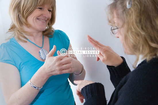 Welfare rights officer and client signing at The Nottinghamshire Deaf Society,