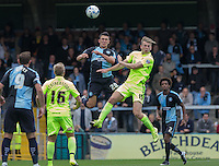 Luke O'Nien of Wycombe Wanderers and Rhys Oates of Hartlepool United go up for the ball during the Sky Bet League 2 match between Wycombe Wanderers and Hartlepool United at Adams Park, High Wycombe, England on 5 September 2015. Photo by Andy Rowland.