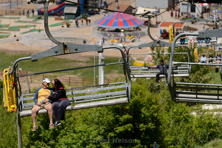 Trent Nelson  |  The Salt Lake Tribune<br /> A couple gets close on the scenic lift at the Park City Mountain Resort, Saturday June 6, 2015.