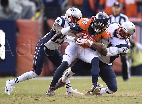 24.01.2016. Denver, Colorado, USA. The NFL AFC Championship American Football match. Broncos wide receiver Demaryius Thomas is brought down by Patriot defenders Malcolm Butler, left, and Jamie Collins after a reception during the second quarter of the AFC Championship game on Sunday
