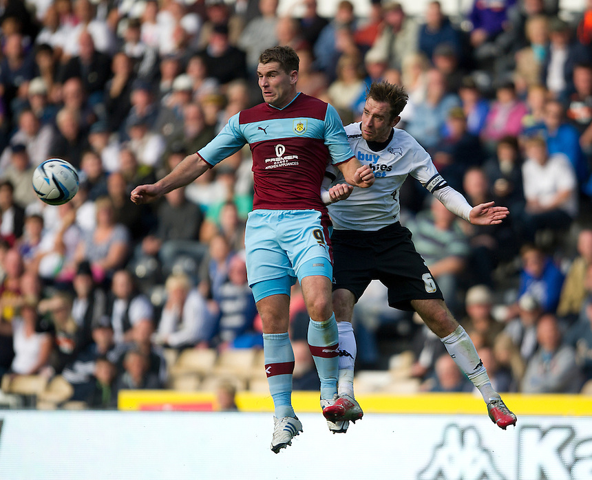 Burnley's Sam Vokes and Derby County's Richard Keogh ..Football - npower Football League Championship - Derby County v Burnley - Saturday 22nd September 2012 - Pride Park - Derby..