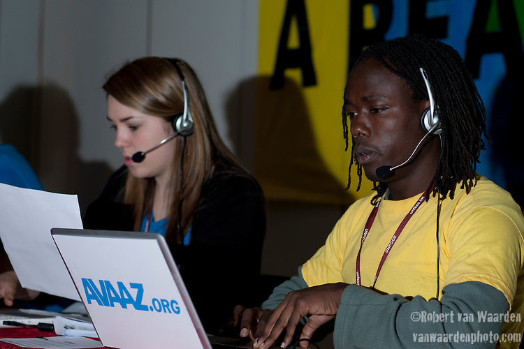Avaaz Activists preform a call in to the EU during the third day of the UN climate talks in Copenhagen. (Credit: Robert van Waarden/Avaaz.org)