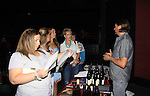 John Wright with fans at a Wine Tasting for Standing Sun Wines on August 11, 2012 at MaGooby's Joke House in Timonium, Maryland. The fans got a chance to takes all the various wines, a Q&A, photos, autographs. L(Photo by Sue Coflin/Max Photos)