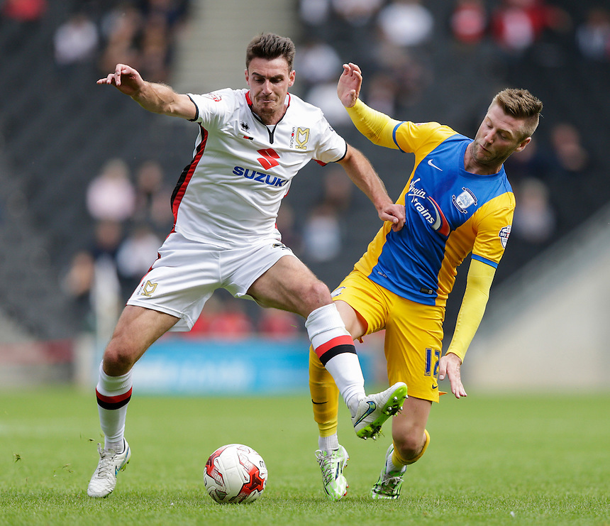 Milton Keynes Dons' Darren Potter is tackled by Preston North End's Paul Gallagher<br /> <br /> Photographer Craig Mercer/CameraSport<br /> <br /> Football - The Football League Sky Bet Championship - Milton Keynes Dons v Preston North End - Saturday 15th August 2015 - Stadium:mk - Milton Keynes<br /> <br /> &copy; CameraSport - 43 Linden Ave. Countesthorpe. Leicester. England. LE8 5PG - Tel: +44 (0) 116 277 4147 - admin@camerasport.com - www.camerasport.com