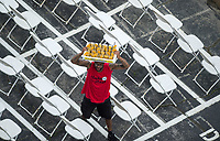 BALTIMORE, MD - MAY 20: A vendor holds drinks above his head as he walks through chairs on the apron of the grandstands on Preakness Stakes Day at Pimlico Race Course on May 20, 2017 in Baltimore, Maryland.(Photo by Scott Serio/Eclipse Sportswire/Getty Images)
