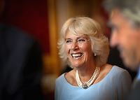 12 July 2016 - London, England - Camilla, Duchess of Cornwall, laughs as she hosts the 30th Anniversary Garden Party for the National Osteoporosis Society in St James Palace in London. Due to inclement weather the event was moved indoors. The Duchess of Cornwall has been connected with the charity for nearly 30 years. Photo Credit: ALPR/AdMedia