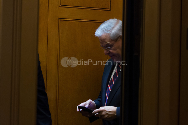 United States Senator Bob Menendez (Democrat of New Jersey) exits the US Senate chamber in the US Capitol after a procedural vote on Friday, December 1, 2017. <br /> Credit: Alex Edelman / CNP /MediaPunch