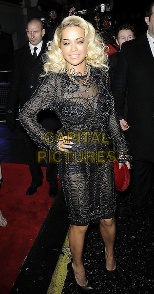 Rita Ora.The ELLE Style Awards 2012, Savoy hotel, The Strand, London, England, .February 13th, 2012.full length black crochet lace dress side hand on hip.CAP/CAN.©Can Nguyen/Capital Pictures.