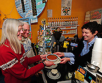 Stephanie Rearick (right) serves vegan tomato tortilla soup and a cupcake to Sharon Larson and Steve Landkamer at Mother Fool's Coffeehouse