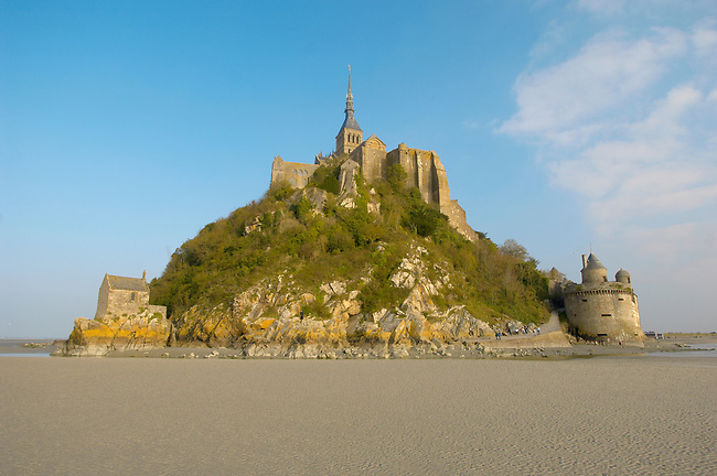 Mont Saint-Michel at low tide with Saint Auberts Chapel and Gabriel's Tower- Brittany - France