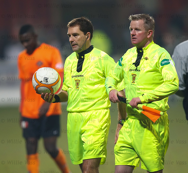 Referee Dougie MacDonald walks off the park with his linesman Gary Sweeney