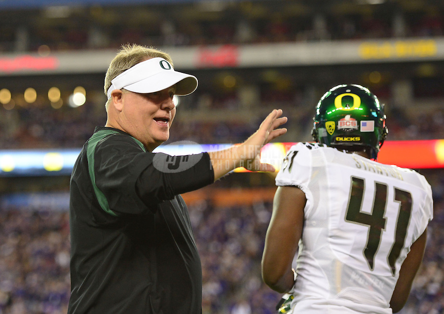 Jan. 3, 2013; Glendale, AZ, USA: Oregon Ducks head coach Chip Kelly against the Kansas State Wildcats during the 2013 Fiesta Bowl at University of Phoenix Stadium. Mandatory Credit: Mark J. Rebilas-
