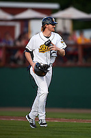 Burlington Bees Trevor Gretzky (29) jogs to the dugout in between innings after coaching first during a game against the Clinton LumberKings on August 20, 2015 at Community Field in Burlington, Iowa.  Burlington defeated Clinton 3-2.  (Mike Janes/Four Seam Images)