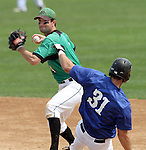 SIOUX FALLS, SD - AUGUST 18:  Brian McGuire #4 from the Renner Monarchs looks to turn a double play as Dan Morrison #31 from the Sioux Falls Brewers slides into second during the fifth inning Sunday afternoon during the Class A Amateur Baseball Tournament at the Sioux Falls Stadium. (Photo by Dave Eggen/Inertia)