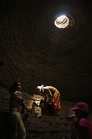 Brick making is typically a manual process a Brick Kiln in the rural area of Battambang