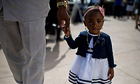 HALLANDALE BEACH, FL - JANUARY 27: A young fan and her father walk around the grand stands on Pegasus World Cup Invitational Day at Gulfstream Park Race Track on January 27, 2018 in Hallandale Beach, Florida. (Photo by Scott Serio/Eclipse Sportswire/Getty Images)