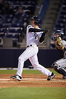 Tampa Yankees first baseman Mandy Alvarez (34) follows through on a swing during a game against the Lakeland Flying Tigers on April 7, 2017 at George M. Steinbrenner Field in Tampa, Florida.  Lakeland defeated Tampa 5-0.  (Mike Janes/Four Seam Images)