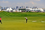 30 August 2009: Paul Goydos putts on the 1st hole during the final round of The Barclays PGA Playoffs at Liberty National Golf Course in Jersey City, New Jersey.